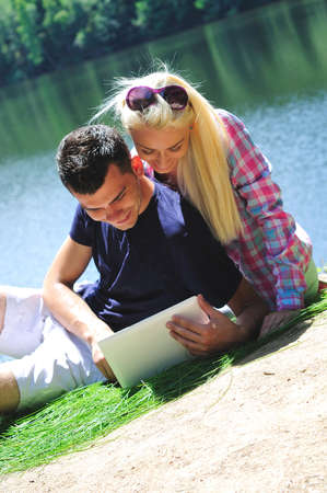 Young couple at notebook in nature photo
