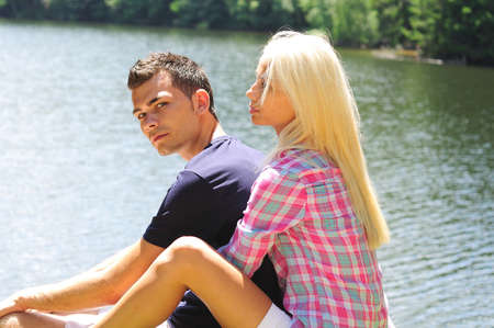 Young couple hug at lake photo