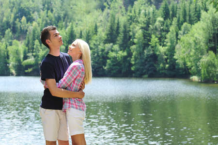 Young couple hug at lake Stock Photo - 14465246