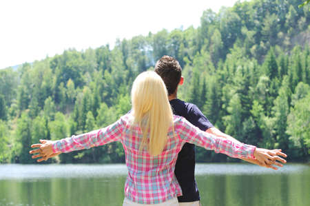 Young couple freedom at lake photo
