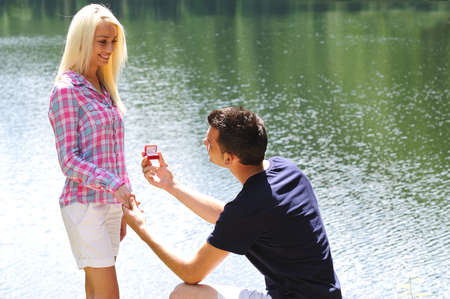 Young man propose his girlfriend photo