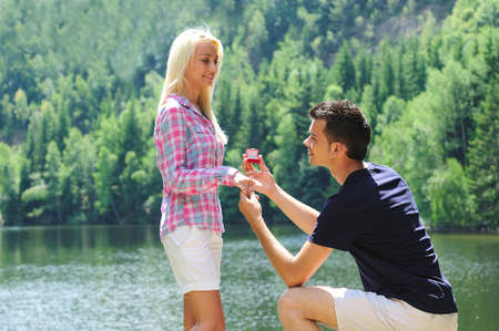 engagement: Young man propose his girlfriend