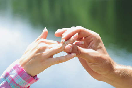 Closeup of giving the ring in nature photo