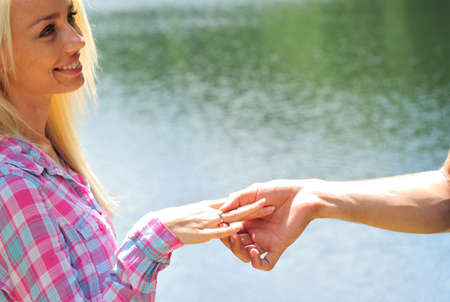 proposed: Young girl is proposed at lake