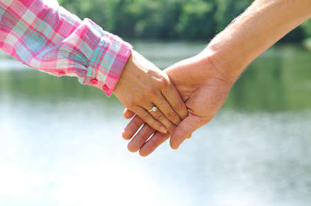 Couple holding hands closeup in nature Stock Photo - 14465076