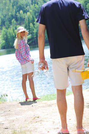 Young couple celebrating at lake photo