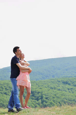 Young couple hugging in nature photo