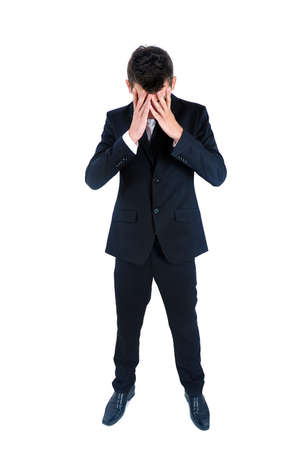 body pain: Isolated young business man depressed Stock Photo