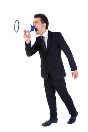 Isolated young business man with loudspeaker