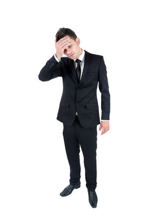 sad businessman: Isolated young business man headache Stock Photo