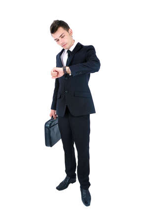 black clock hands: Isolated young business man watching at clock Stock Photo