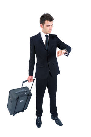 Isolated young business man with luggage photo