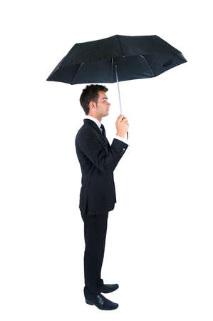 Isolated young business man with umbrella