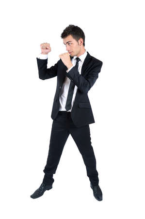 Isolated young business man fight photo
