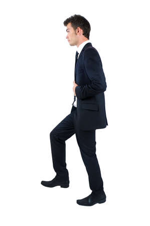 Isolated young business man foot up Foto de archivo