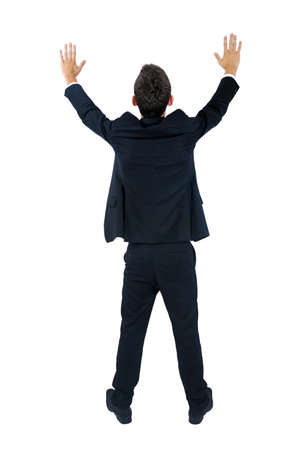 Isolated young business man hands up photo