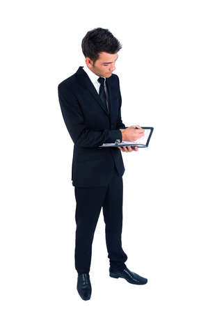 Isolated young business man with notebook Stock Photo - 14664555