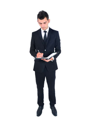 Isolated young business man with notebook Stock Photo - 14664444
