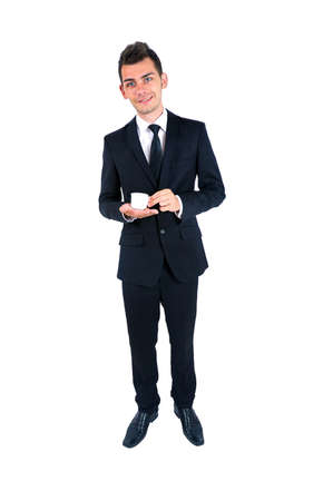 Isolated young business man with coffe photo