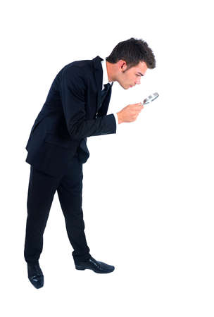 magnifying glass: Isolated young business man with magnifying glass