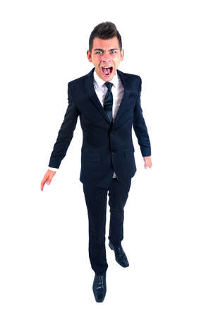 Isolated young business man screaming photo