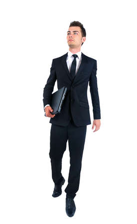 Isolated young business man walking