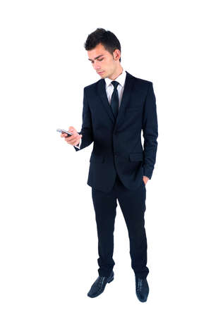 Isolated young business man with phone Stock Photo - 14664544