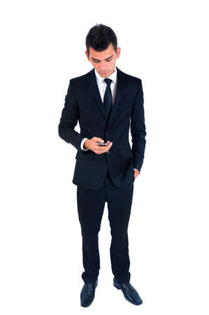 Isolated young business man with phone Stock Photo - 14664643