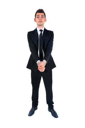 prisoner man: Isolated young business man tied  Stock Photo