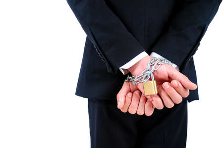 Isolated Business man tied with chain photo