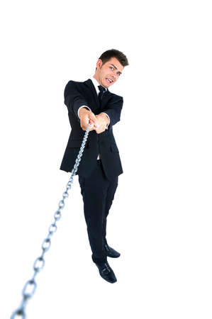 Isolated young business man pull chain photo