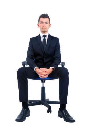 Isolated young business man standing on chair photo