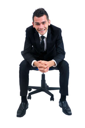 man in chair: Isolated young business man standing on chair Stock Photo