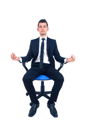 Isolated young business man relaxing on chair photo
