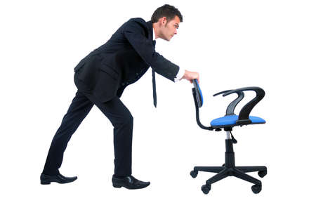 Isolated business man pushing chair