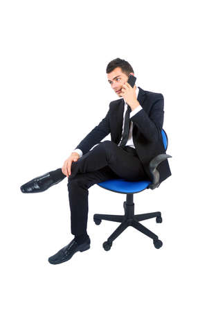 Isolated young business man with phone photo