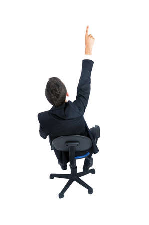 arms chair: Isolated young business man pointing