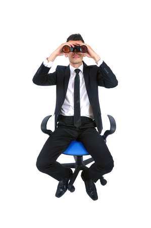 man looking out: Isolated young business man with binocular