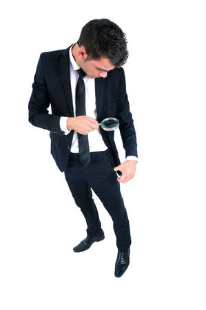 money in pocket: Isolated young business man with magnifying glass