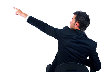 arm chairs: Isolated young business man pointing