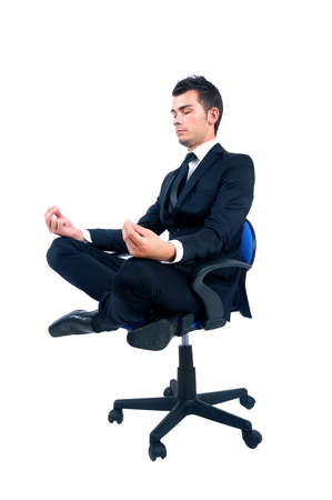 Isolated young business man relaxing photo
