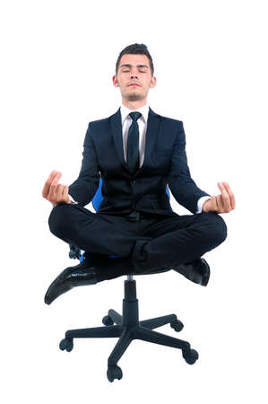 meditation isolated white: Isolated young business man relaxing