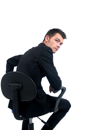 Isolated young business man sitting on chair photo