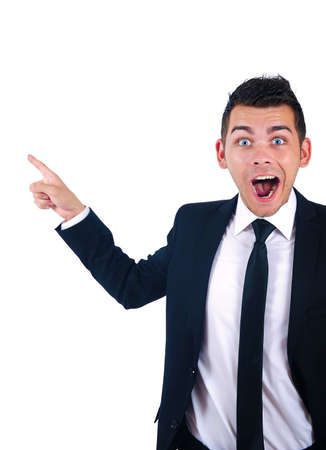 Isolated young business man pointing amazed Stock Photo