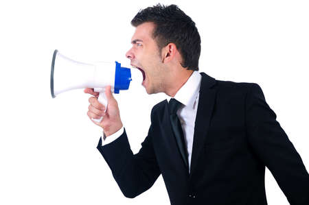 Isolated young business man with loudspeaker photo