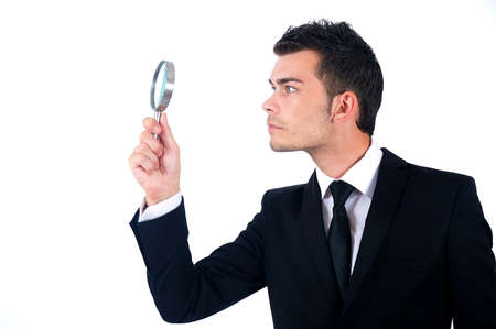 executive job search: Isolated young business man with magnifying glass