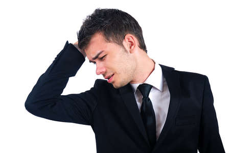 Isolated young business man headache photo