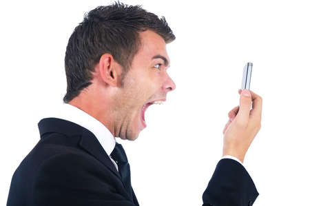 Isolated young business man screaming at phone photo