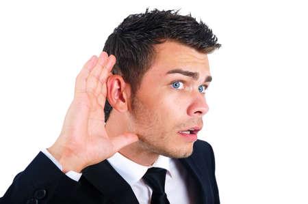 oir: El hombre de negocios aislado joven que escucha