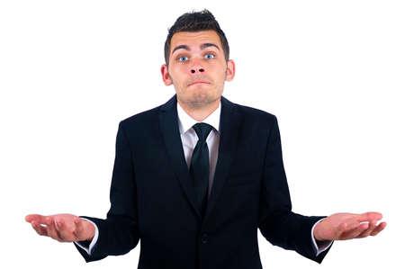 Geïsoleerde jonge verward zakenman Stockfoto